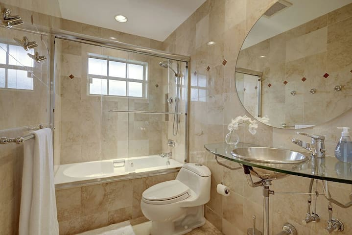 Hall bath with jacuzzi tub and shower