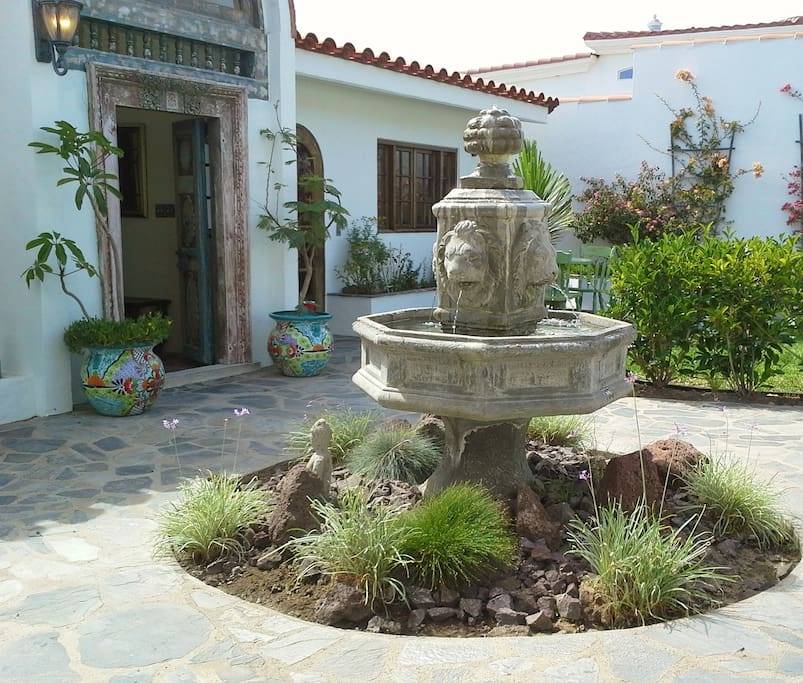 Fountain in front of the Main House and the Guest House -- Guest House entrance is one the left