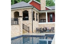 Pool just below the outdoor kitchen and porch