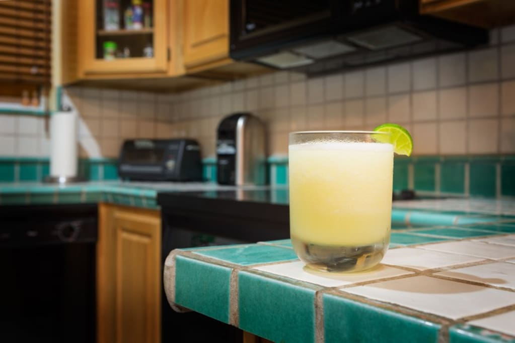 Traditional Mexican tiled kitchen is well equipped for making tasty frozen margaritas!