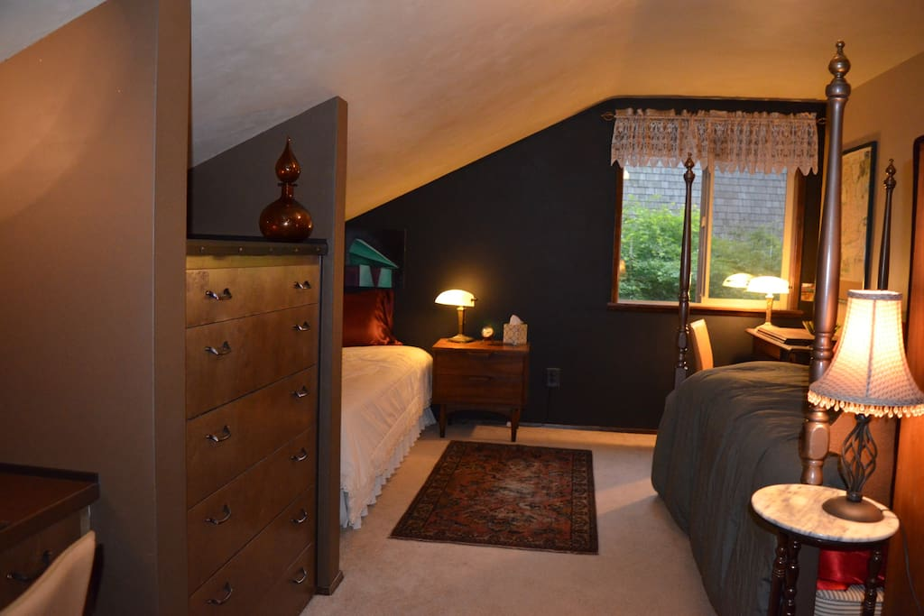 One mile from Chambers Bay! This second floor room has been created with the Steampunk style in mind. It features two single beds, two desks, a closet and 4 dresser drawers. We could accommodate and get a queen bed in this space if needed. Please contact