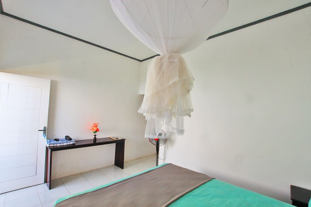 Doublebed room with mosquito net and fan