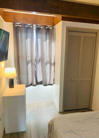 Bedroom 2 w closet and cubbies for storage and TV