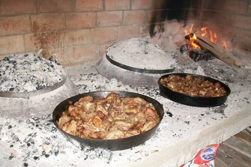 Traditional food: lamb,veal and potatoes under metal bell-sac