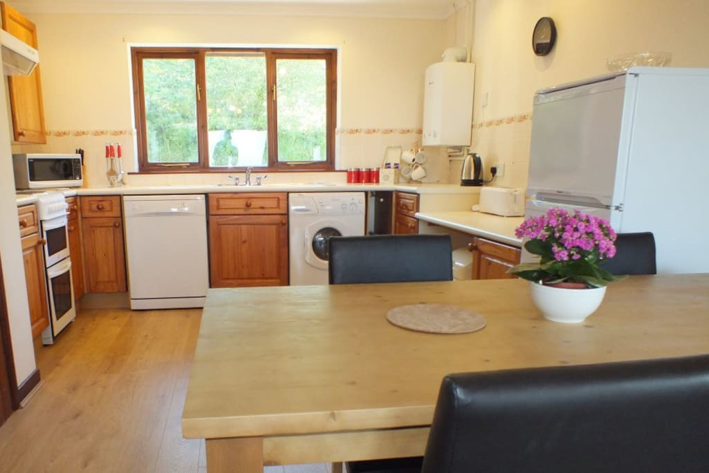 The fully equipped kitchen/diner is fitted with double oven and hob, microwave, fridge/freezer, dishwasher and washer/dryer.