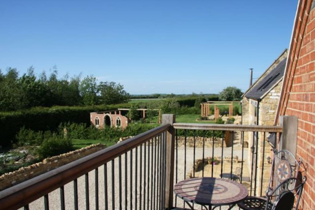 The balcony has a fabulous view across the garden and open fields all the way to the Malvern Hills
