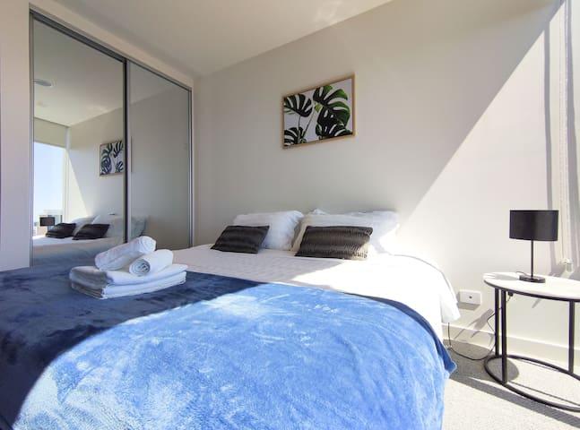 Bedroom with cozy Queen size Bed