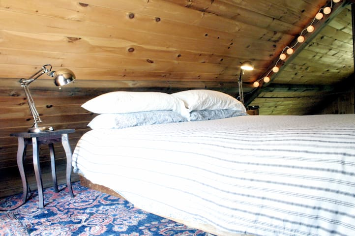 Our guests consistently tell us they love the queen sized bed in the cabin's loft. In the winter we put LL bean flannel on for maximum coziness.