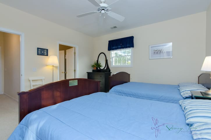 2 full beds with attached Jack and Jill bathroom