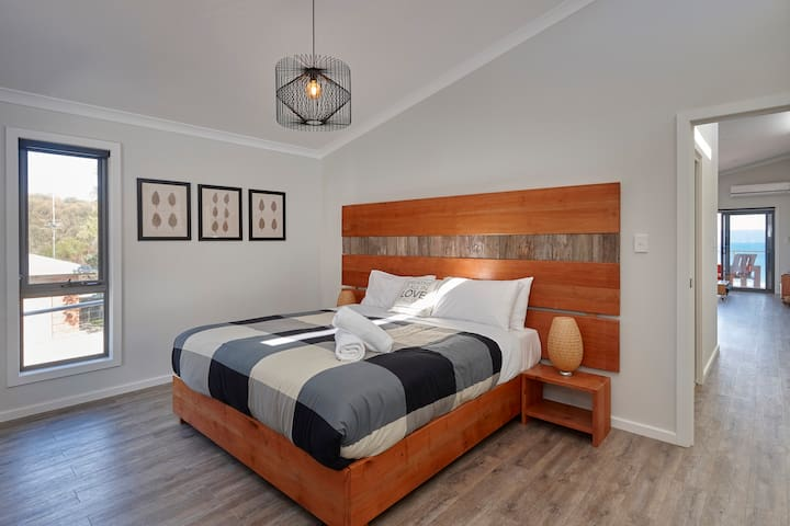 Spacious bedroom with hand crafted timber features