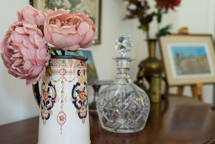 Dining Side Table detail- adorned with antiques and local artist paintings