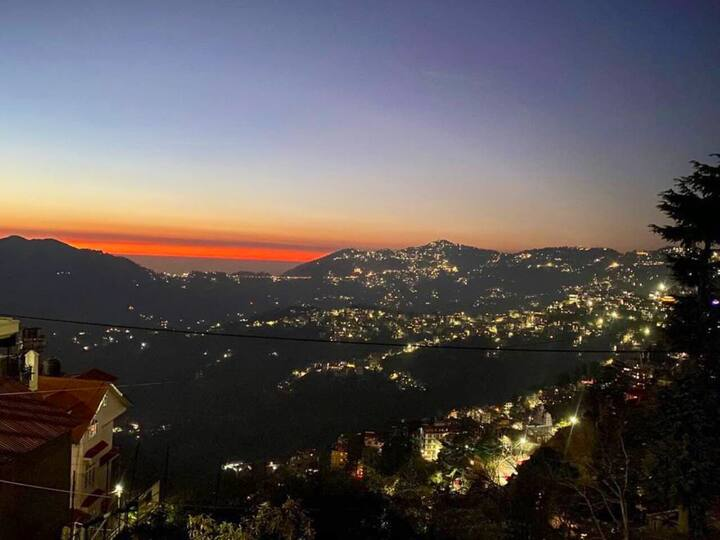 Sunrise view above snowy peak
