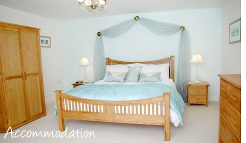 Luxury bedroom with kingsize bed