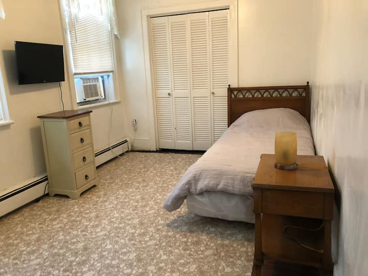 Room near the riverfront, hospital, and highway