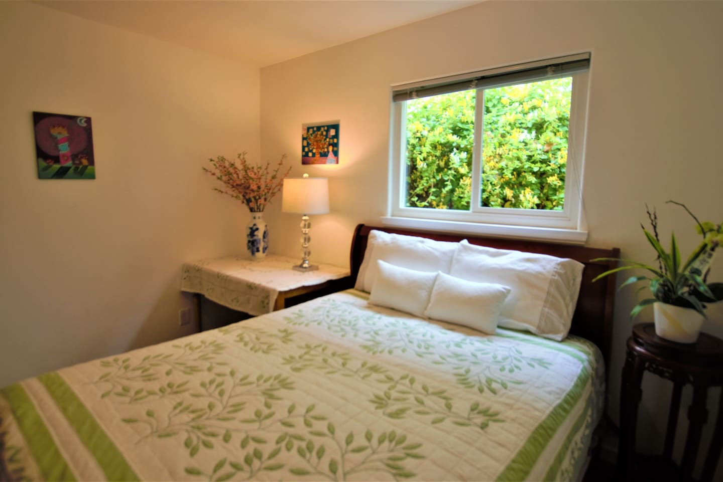 3rd bedroom, with a equally comfortable queen bed and a standard size closet. of course, guests get a view of the nature!
