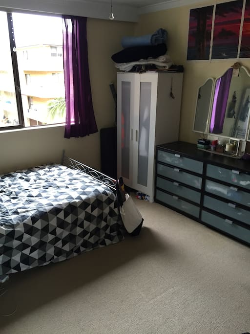 Double bed with closet and chest of drawers