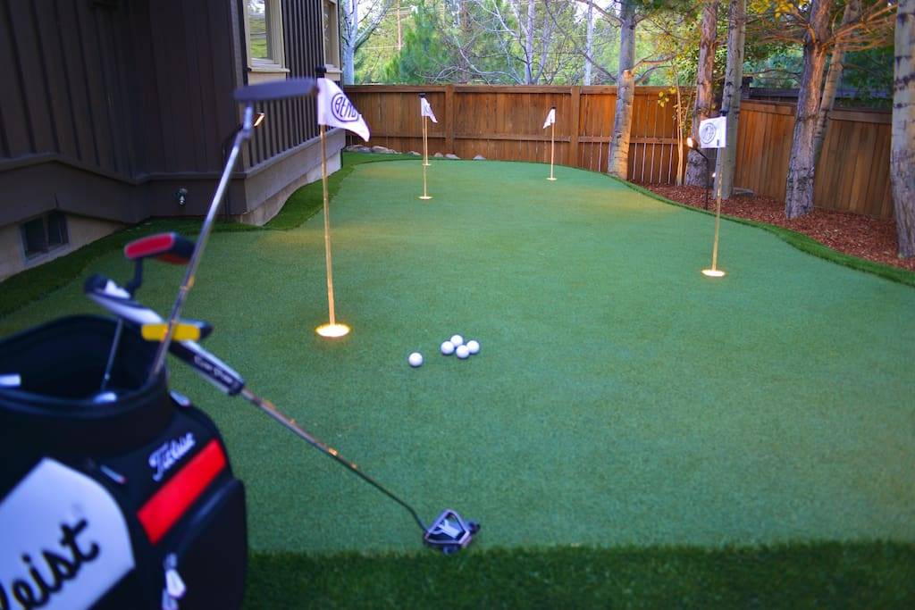 Backyard padio with natural gas barbecue and clubs for everyone to enjoy