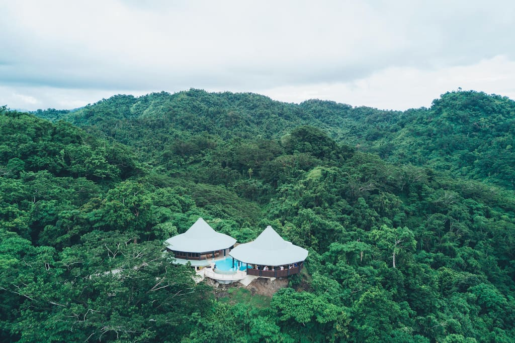 Aerial  view of Mountain Top Villa, surrounded by rainforest and ocean views