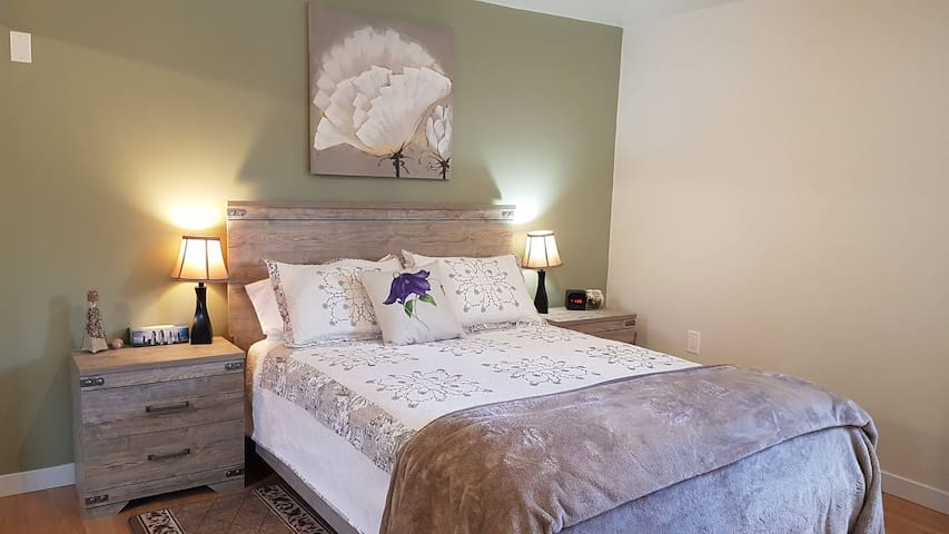 Large bedroom with a very comfortable bed! Room darkening curtains so you can sleep in.