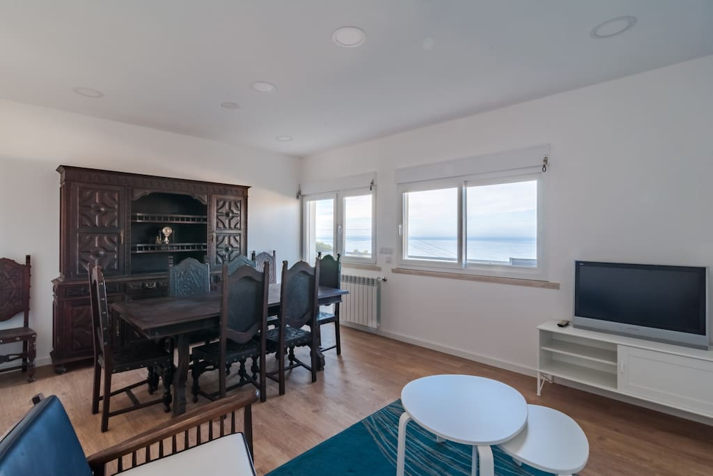 Living/dinning room with view to the beach and down town