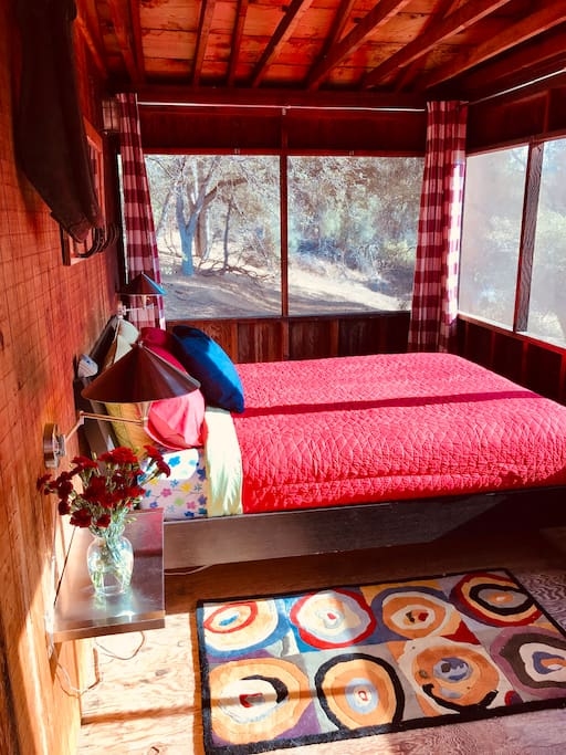 Sleep in the screened in porch overlooking the river.