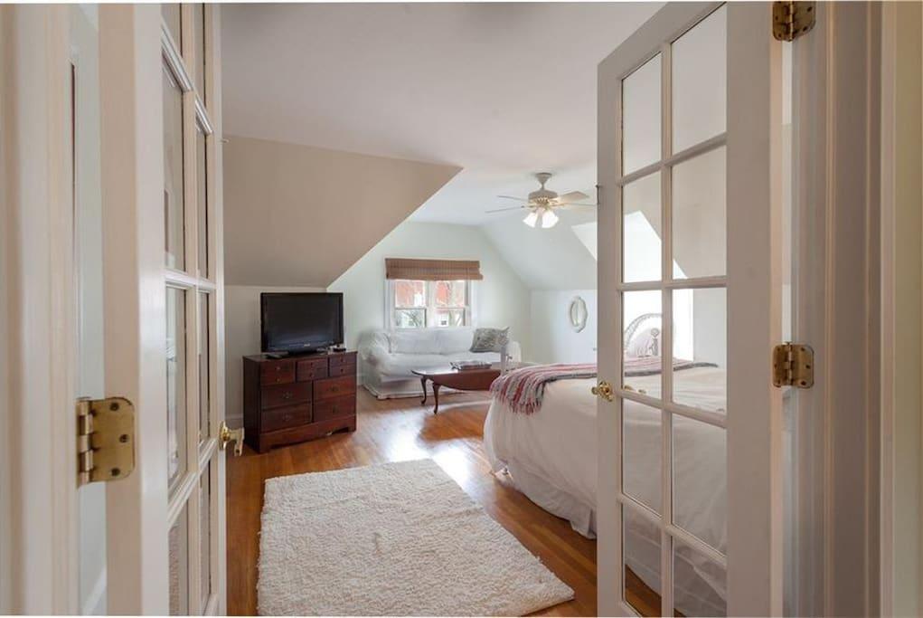 Enter bedroom one through beautiful glass doors.