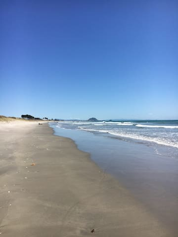 Skip through the dunes to beautiful Papamoa Beach