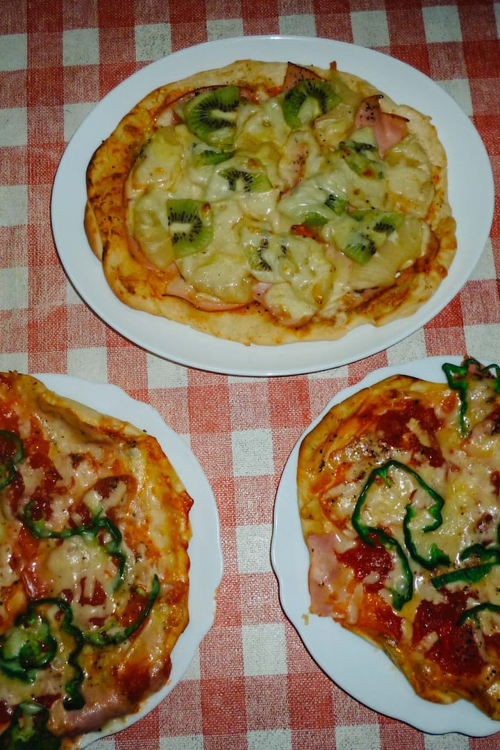 pizza baked by self-made oven