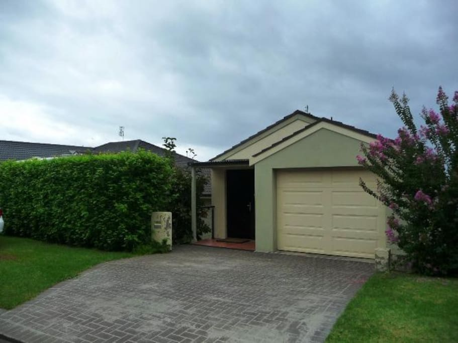 The front of the house. Access to the garage is available