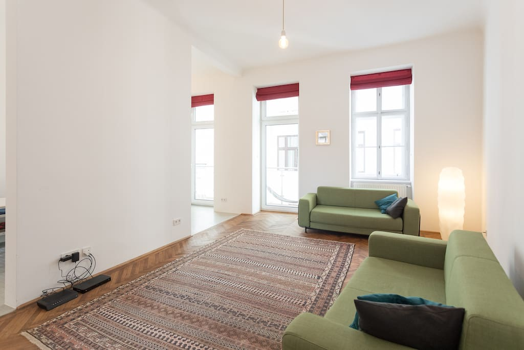 Generous, open and bright living space with two sofa beds and direct access to the balcony
