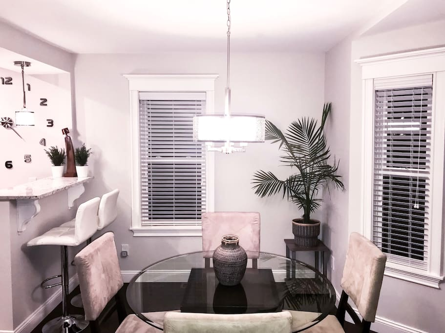 Large Open Dining Room with Round Table and Breakfast Bar