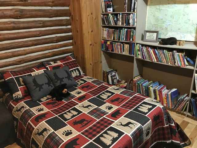 Couples favourite and main bedroom.  Has a selection of books to read in its library. Small desk to do any work needed while enjoying the bliss of our home.
