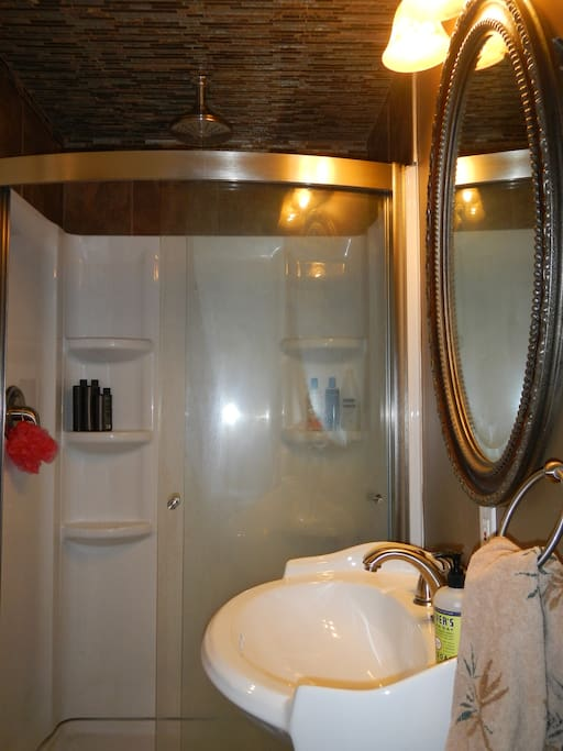 Full bath with rain shower downstairs for your private use