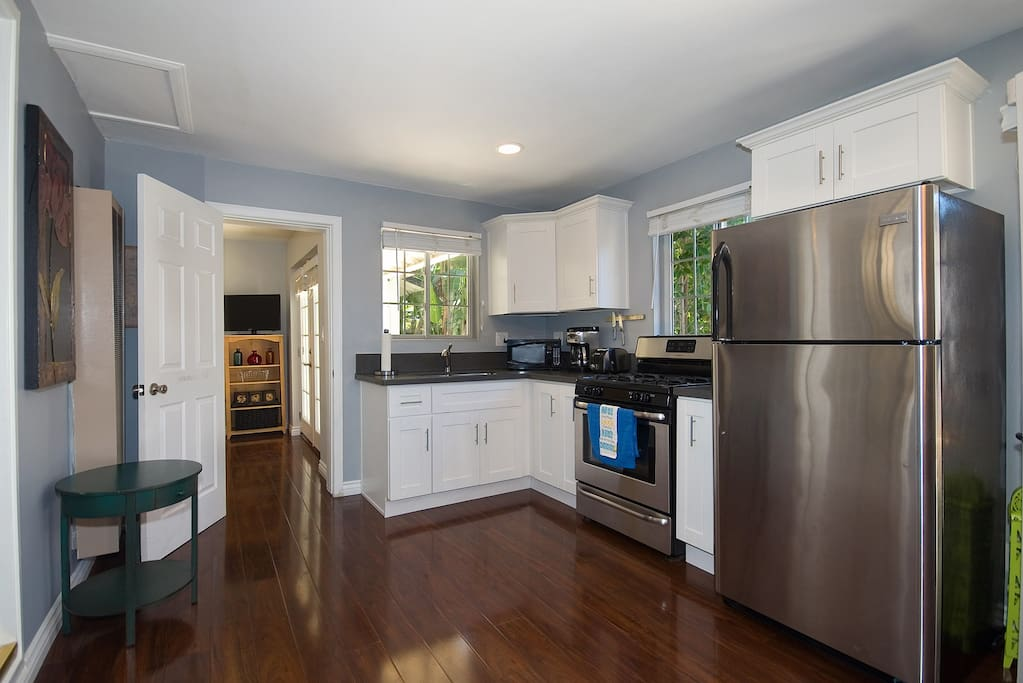 Full stocked kitchen with Stainless steel appliances, and quartz counter topps.