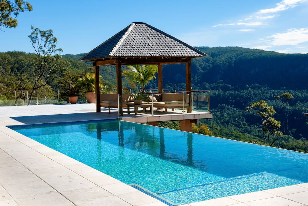 12 x 4 metre infinity pool and large marble decking with comfortable daybeds to lounge around soaking in the views.