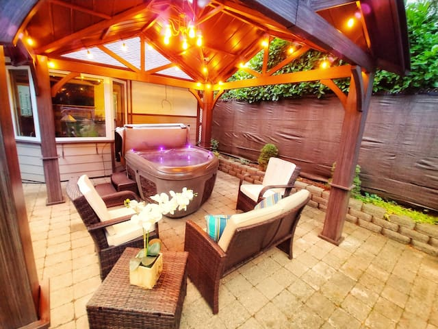 Inviting hot tub, comfortable patio chairs and flowers to make your stay restful, refreshing and enjoyable.
