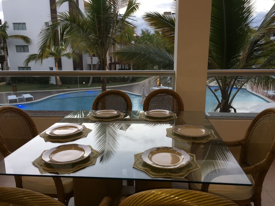 DINING IN BALCONY WITH POOL VIEW