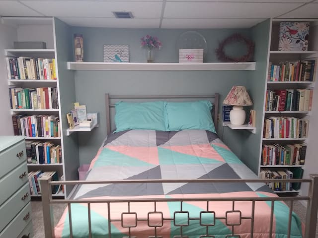 Plenty of closet space throughout the space for our extended stay guests. Comfortable queen size bed with a memory foam mattress, including a wide variety of books for your enjoyment.