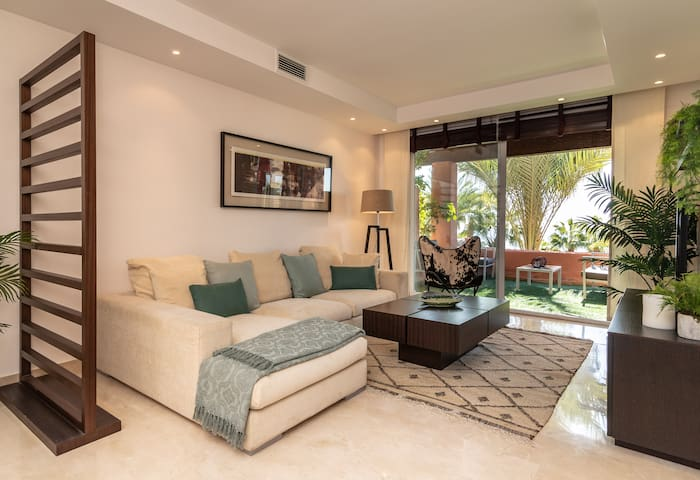 Bright and comfortable living room, TV with international channels