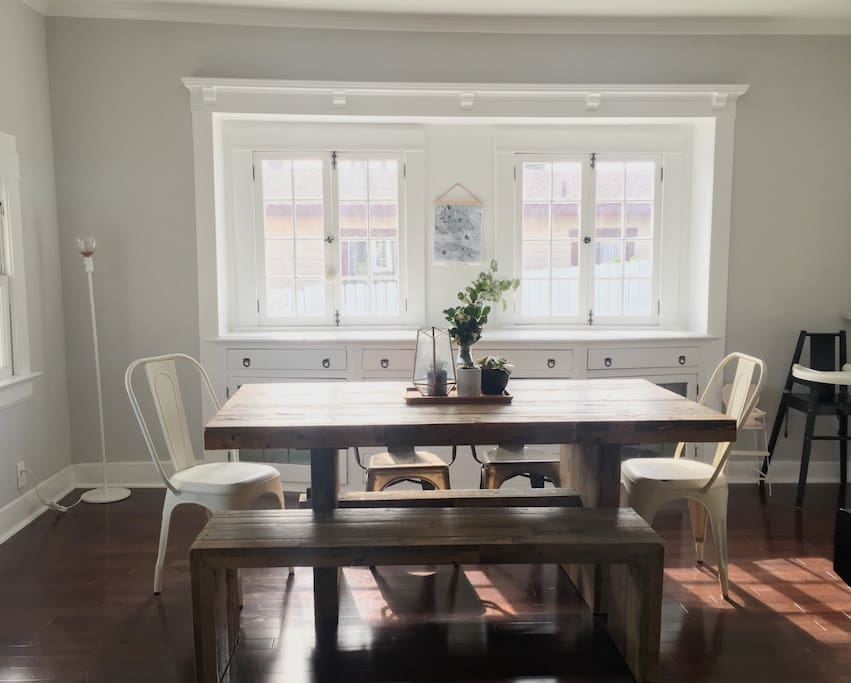 Lots of light in this open dinning room, built in buffet, lots of charm