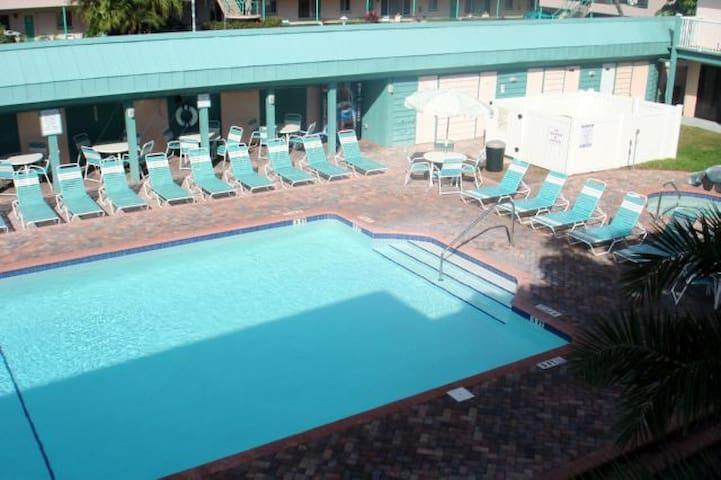 Pool area with hot tub - always plenty of seats