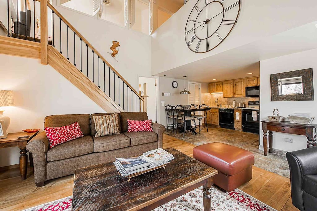 The condo is open concept and the living area is fully furnished with comfortable furnishings, fireplace, hardwood floors and HDTV with satellite TV.