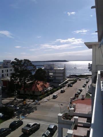 Balcony View: Port, Sea and Isla Gorriti view.