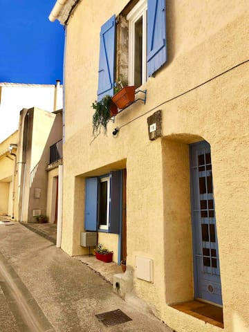 Your ground floor apartment is in this village house on a charming street.