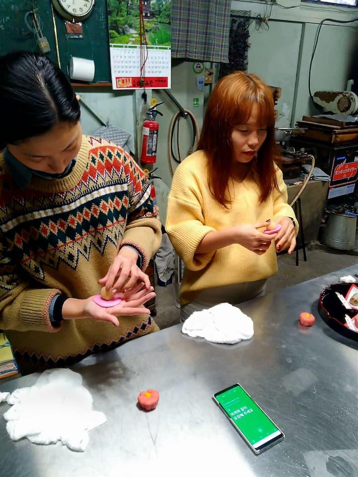 Guests using translation apps for Korean