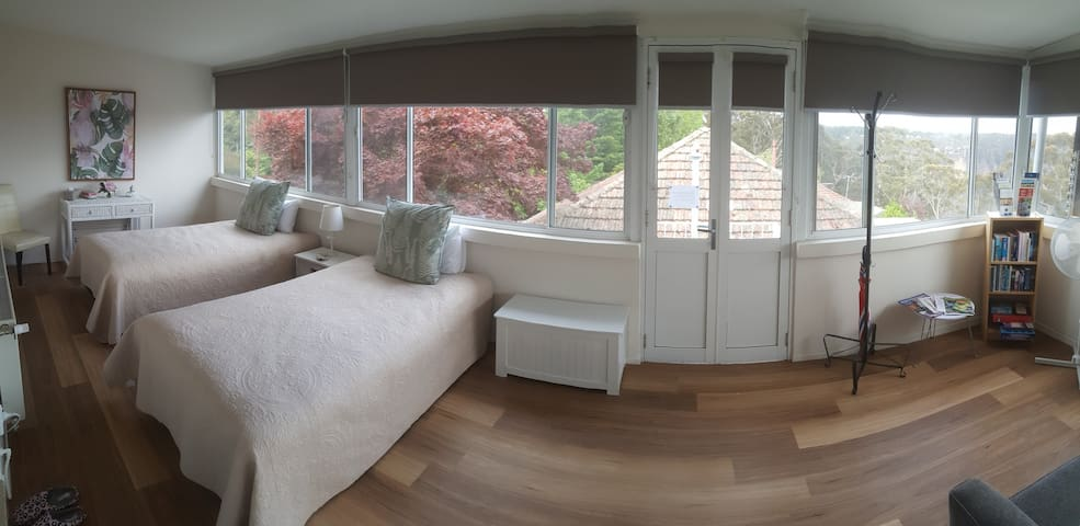 Entry to apartment through Sunroom/bedroom 2 (Panoramic shot)