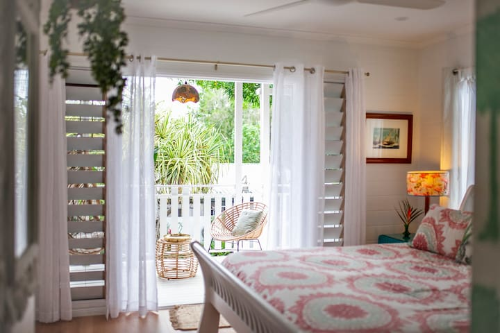 Master Bedroom with Private Balcony,overlooking the pool and gardens