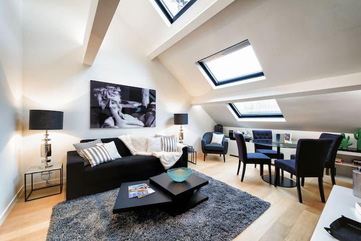 Louise District - Bright Top-Floor Apartment