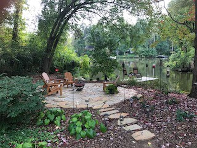 Shared space-Stone patio area next to lake.
