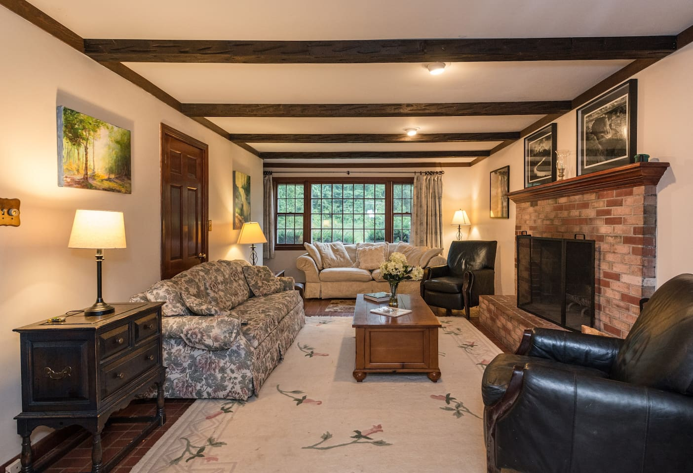 The Family room has plenty of room to gather together with 2 full size couches, 2 lounge chairs, coffee table, TV, and fireplace.